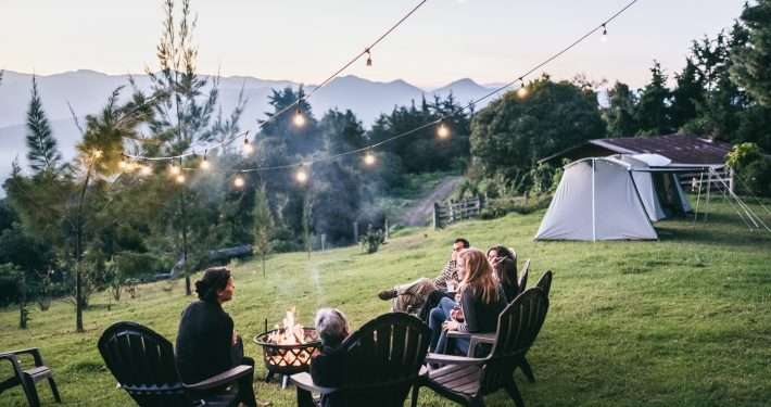 Guests enjoying a campfire and sunset over Antigua Valley.
